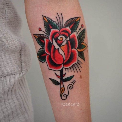 neo-traditional arm rose tattoo