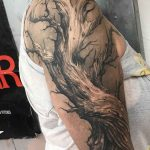 Dead tree tattoo on shoulder