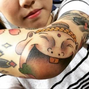 Happy Buddha Tattoo on Elbow