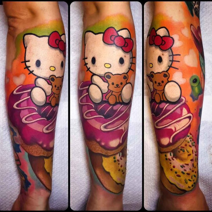 arm tattoo hello Kitty wit donuts