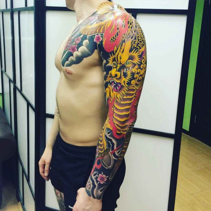 golden dragon full sleeve tattoo