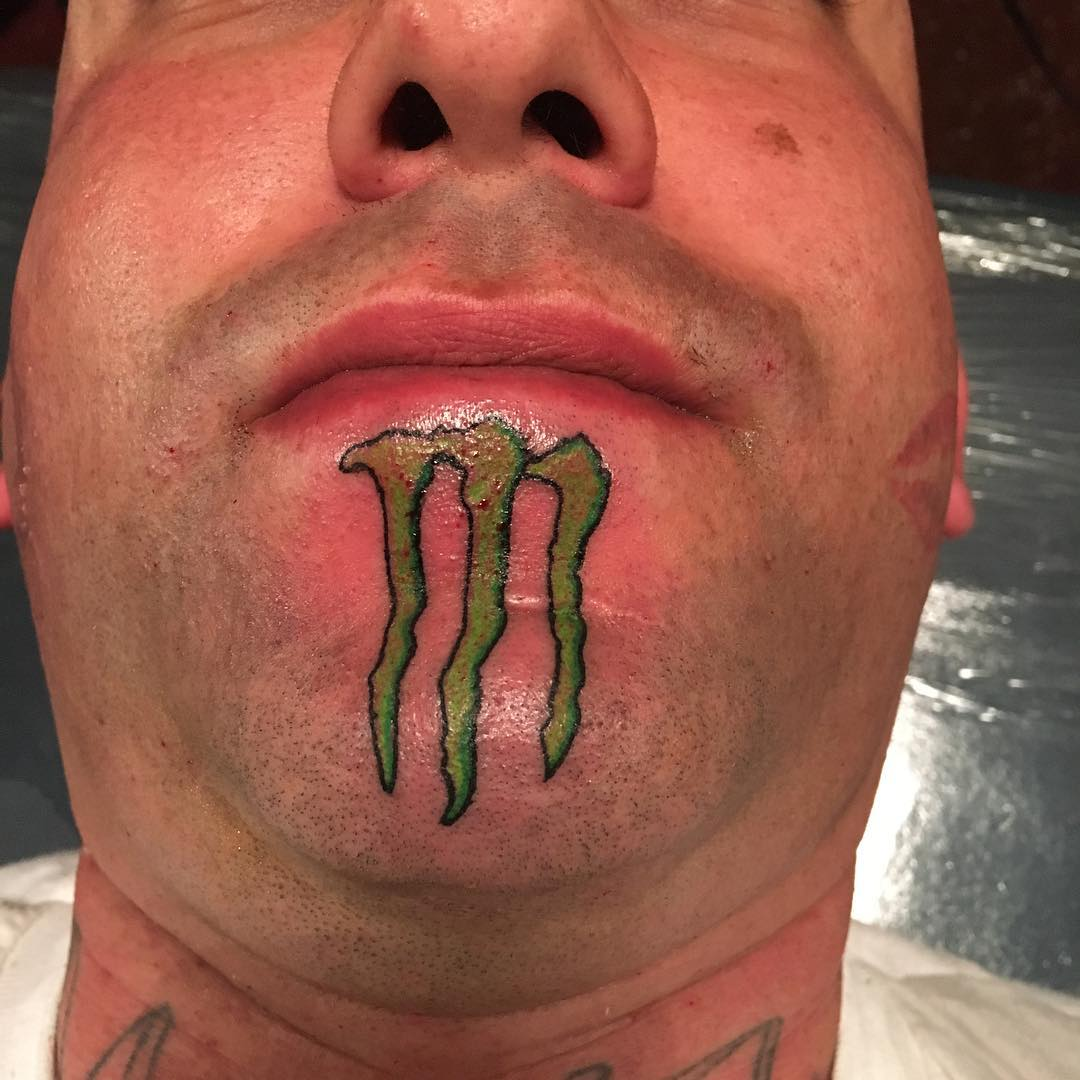 Monster Energy Logo Tattoo on Chin by 23inked