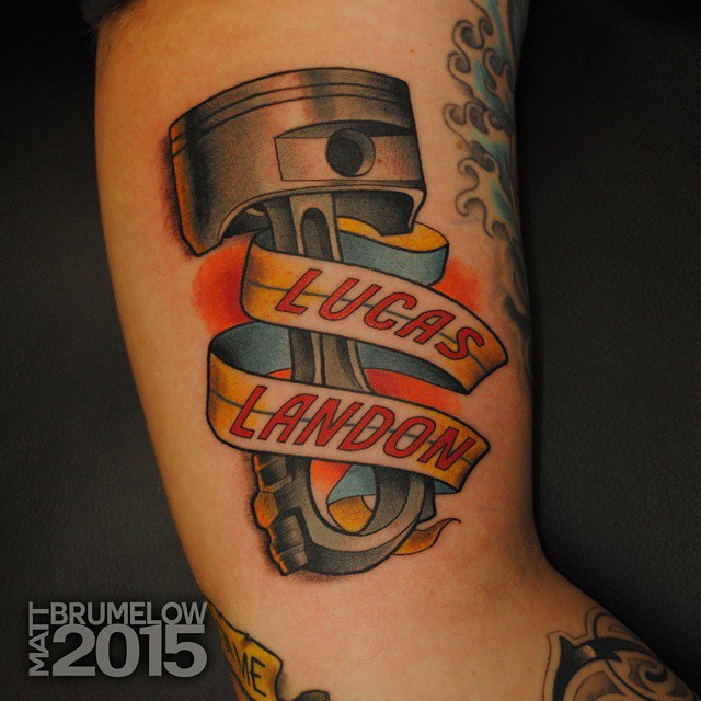 Name Ribbon Piston Tattoo by brumelow_ink
