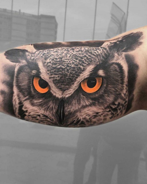 owl tattoo on bicep