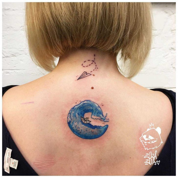 wave tattoo lower neck back