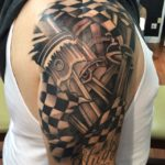 Racing Pistons Tattoo on Shoulder