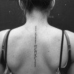 Roman Numerals Back Tattoo