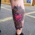 Ruby Rose Tattoo on Calf by nicholsontattoos
