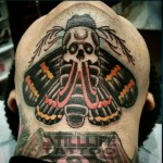 Skull Moth Tattoo Under Chin