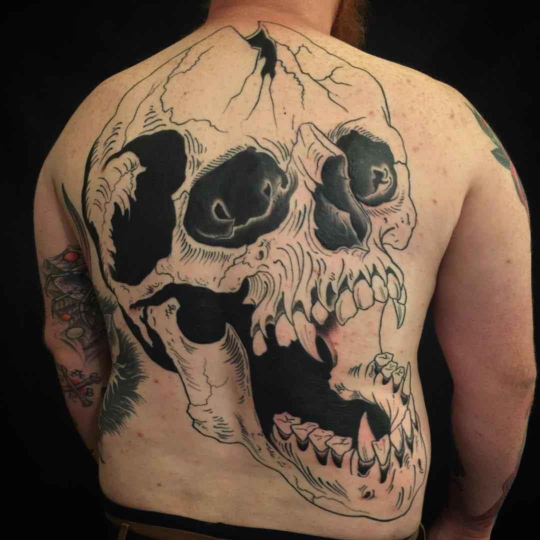 full back skull tattoo blackwork