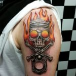 Skull and Piston Tattoo