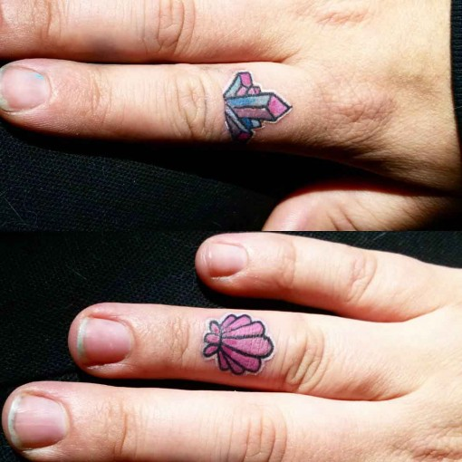 shell and crystal finger tattoos