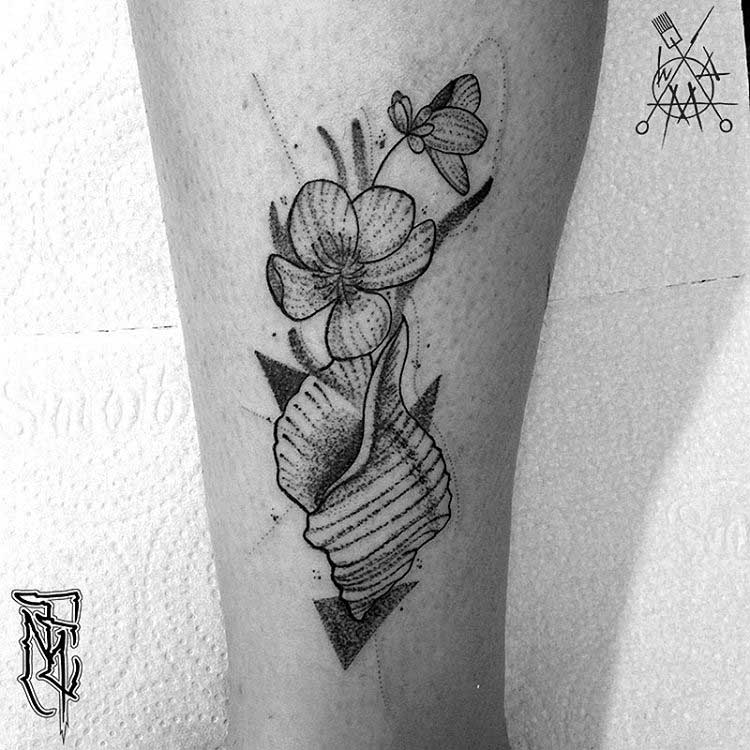 flower and shell dotwork tattoo