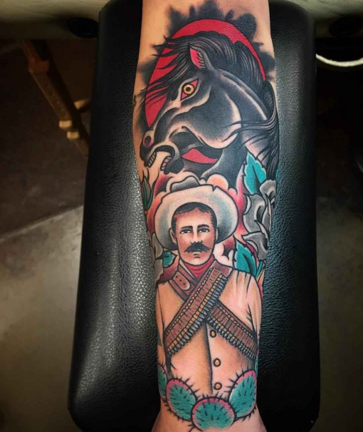 western themed traditional tattoo on arm