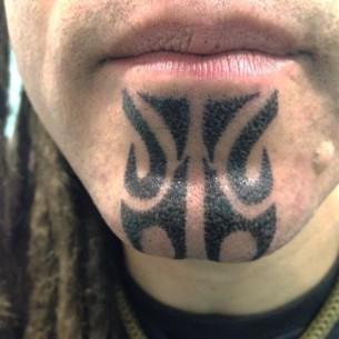 Tribal Chin Tattoo