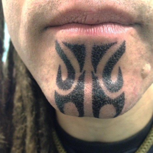 Tribal Chin Tattoo by aidaguidusbodyarts