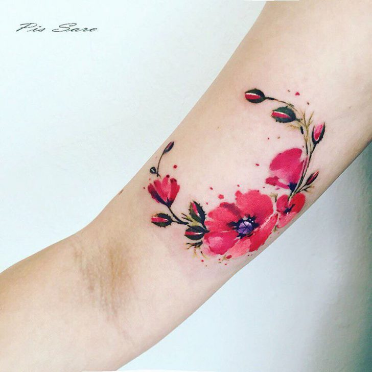 poppies bright tattoo on bicep