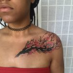 collar bone tattoo cherry blossom