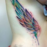 watercolor wing tattoo on ribs