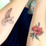 Dove and Flower Tattoos on Forearms