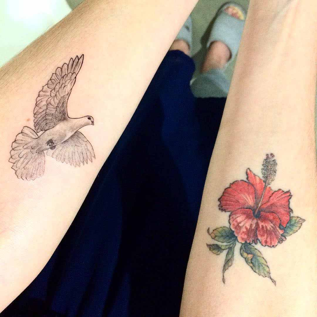 arm tattoos dove and flower