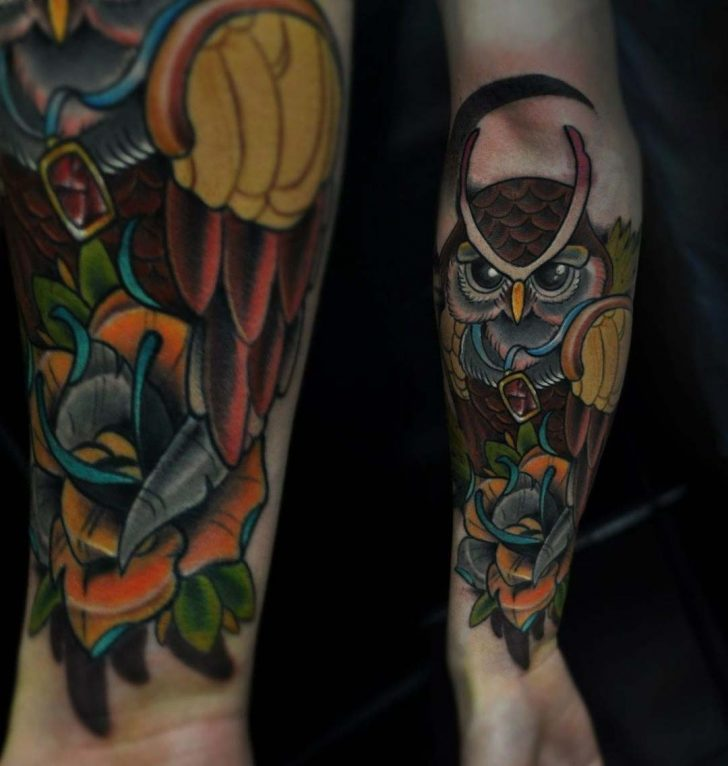 cool owl tattoo on forearm
