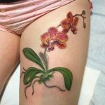 thigh tattoo orchid
