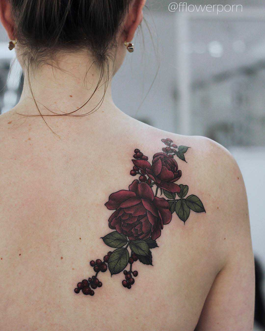 dark red roses tattoo on shoulder blade