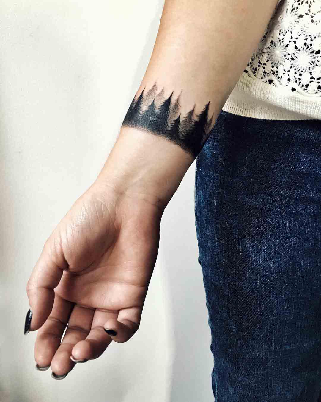 wrist tattoo forest