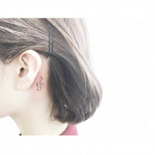 Treble Clef Tattoo Behind Ear