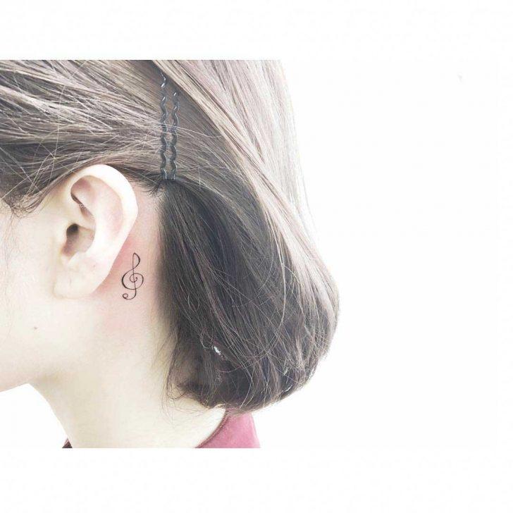 tattoo behind ear treble clef