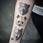 wolf bear panda inner arm tattoos
