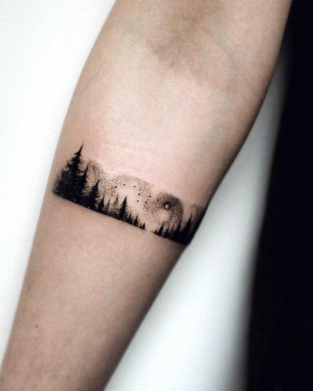 arm tattoo forest