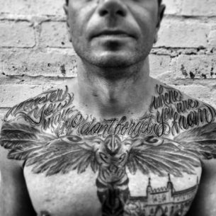 Chicano Lettering Tattoo on Chest