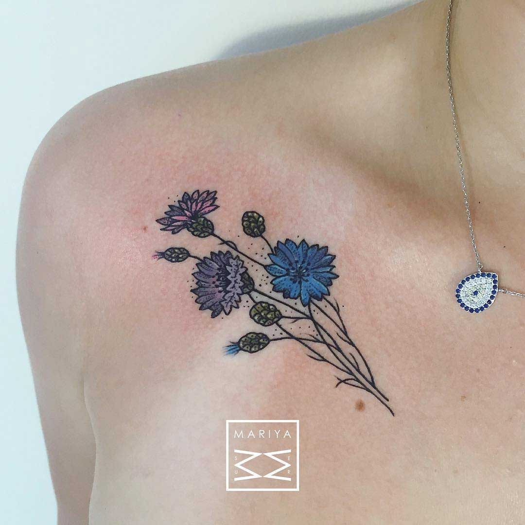 blue flowers tattoo on collar bone