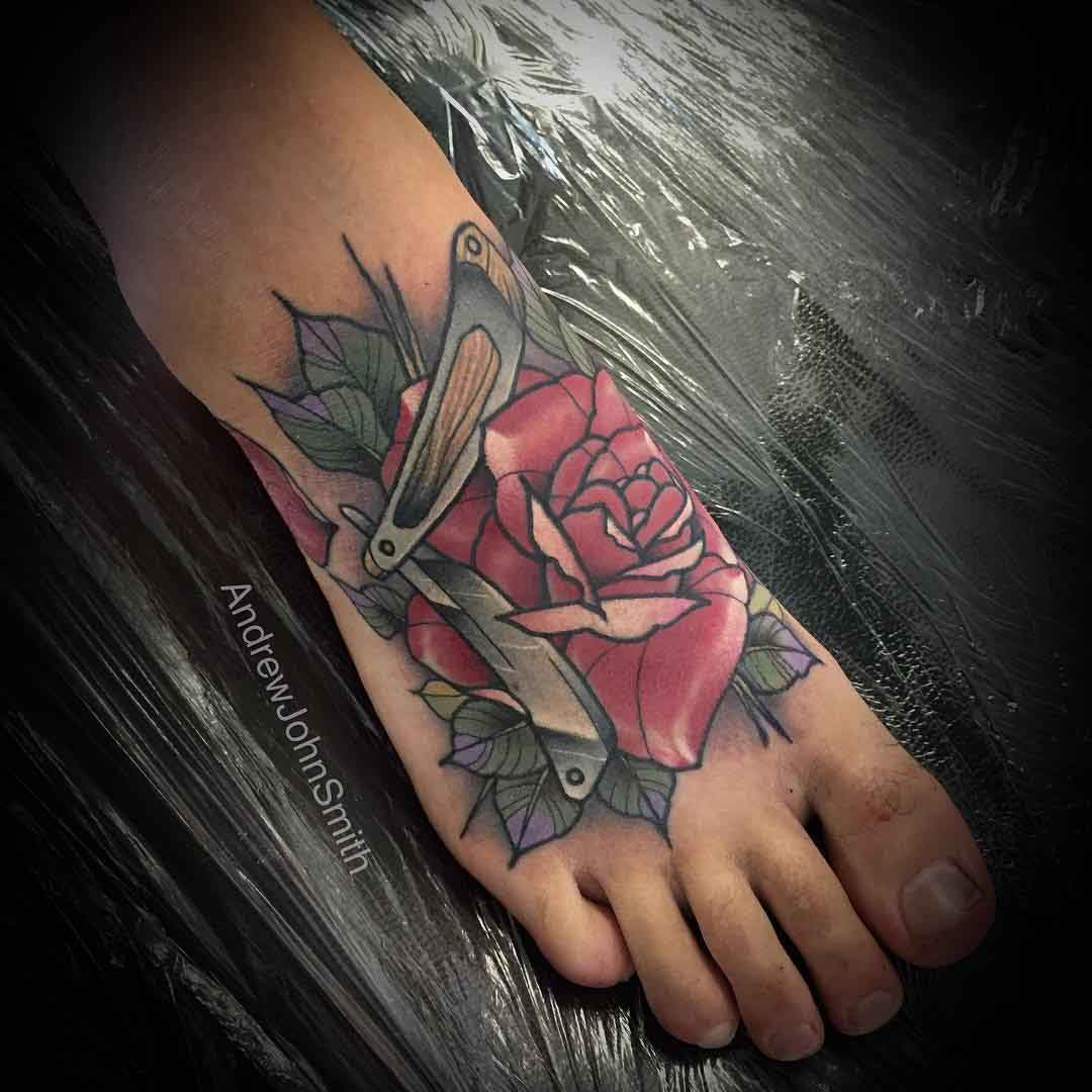 razor and rose tattoo on foot