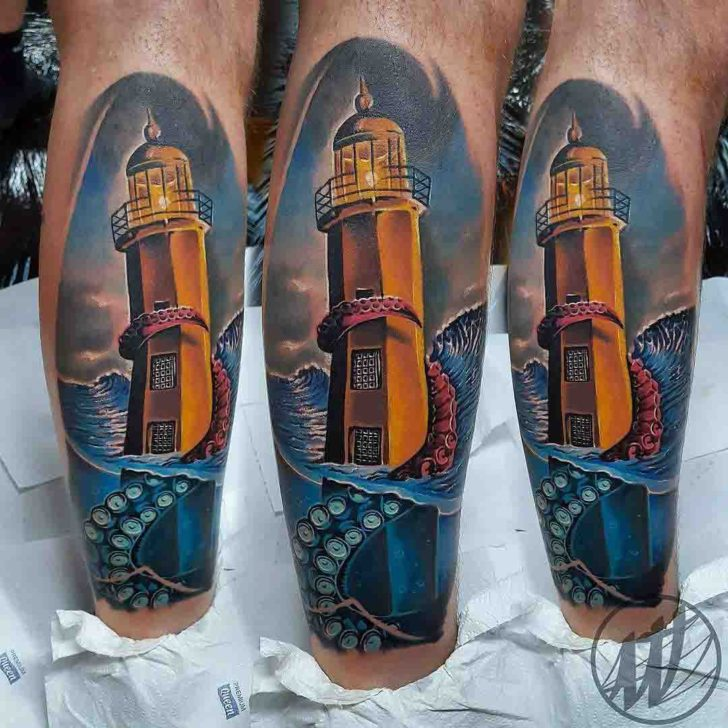 Lighthouse tattoo on calf