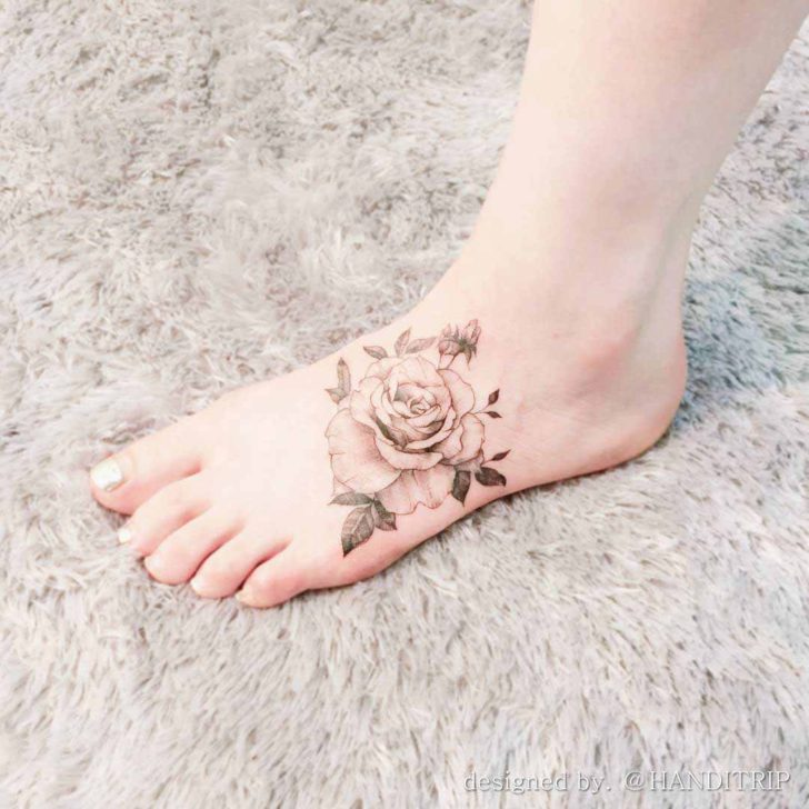 vintage rose tattoo on foot