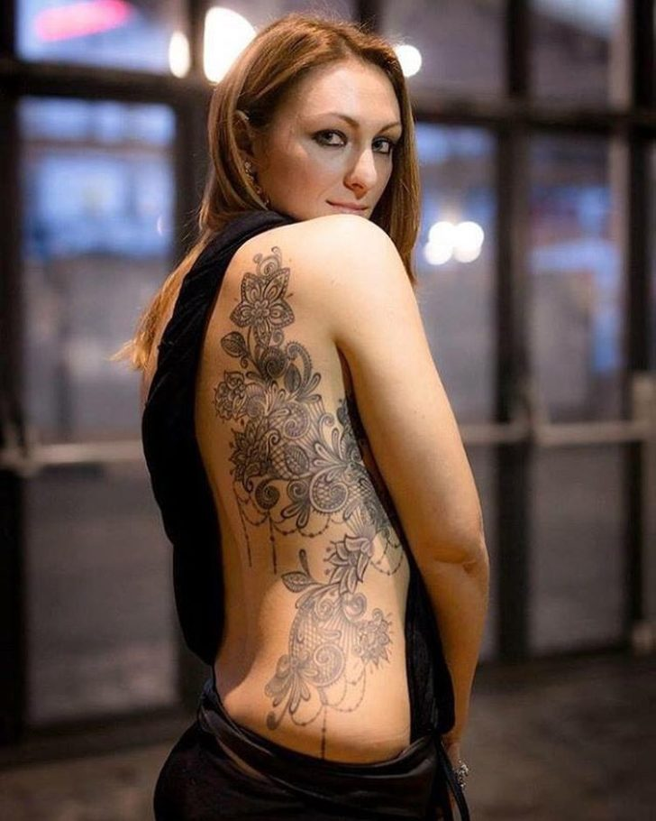 girl tattoo flowers on side