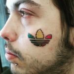 Adidas Logo Tattoo on Face by Kenny Primmer Jr