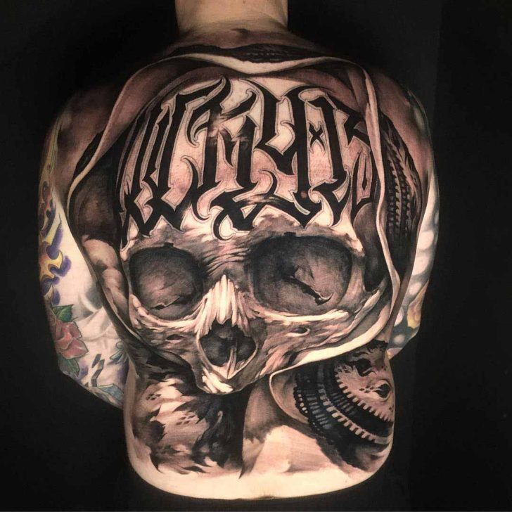 skull tattoo on back chicano style