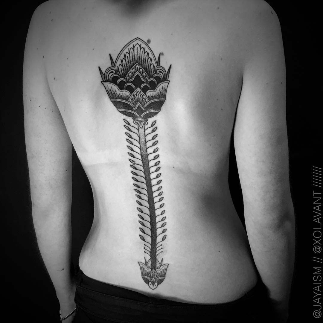 lotus spine tattoo