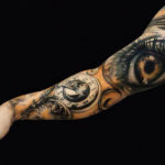 Bicep Eye Sleeve Tattoo