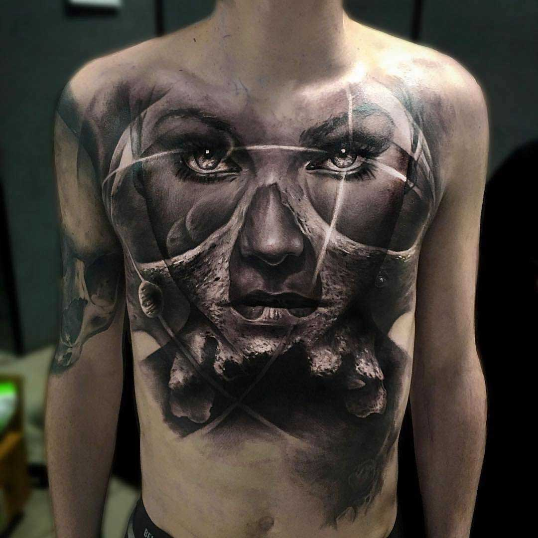 chest tattoo face portrait mixed with skull