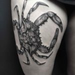 crab tattoo on thigh