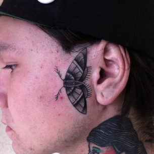Butterfly Face Tattoo
