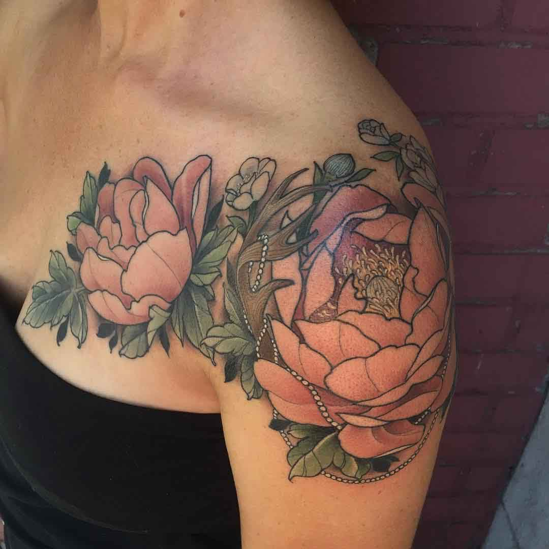 breast to shoulder flowers tattoo