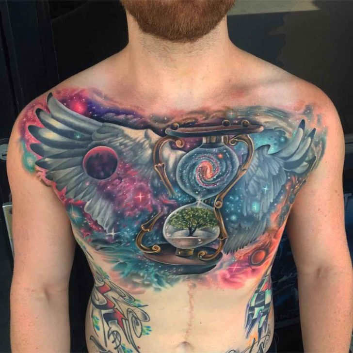 philosophical space themed chest tattoo