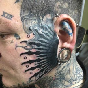 Close to The Ear Face Tattoo