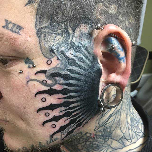 Close to The Ear Face Tattoo by Danny Fogg